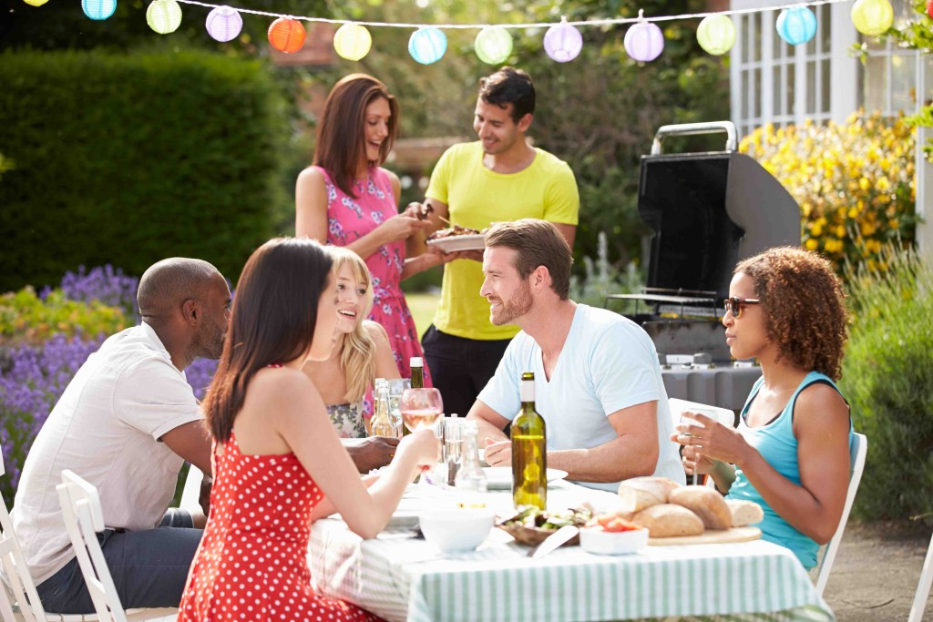 Group Of Friends Having Outdoor Barbeque At Home